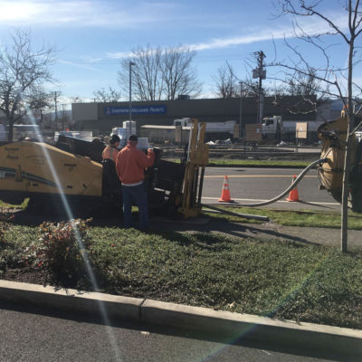 directional drill in action crossing busy intersection traffic control.