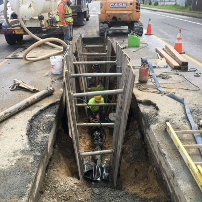 Working in speed shoring for sanitary sewer line install